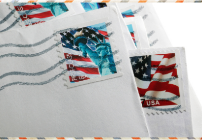 Picture of the corners of letters with postage stamps